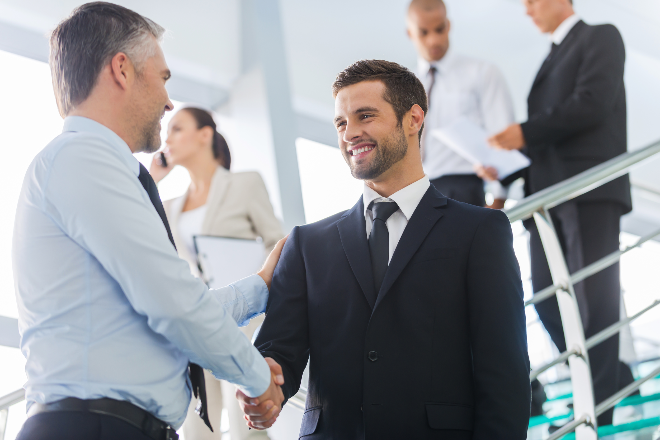 Sales rep and prospect conversation at trade show